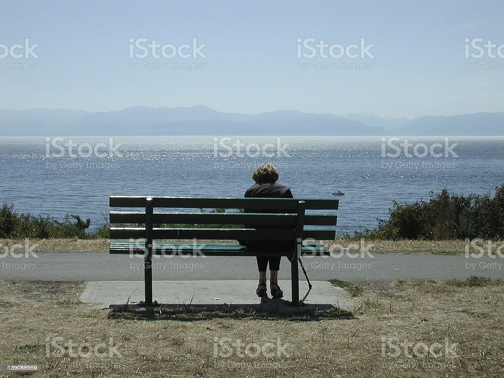 Grandmother looking at the ocean stock photo