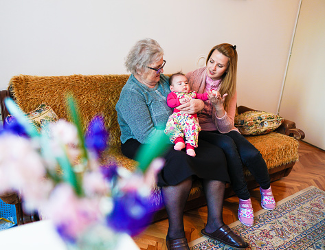 1088637186 istock photo Grandmother, mother and baby at home 1144562732