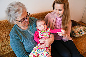 istock Grandmother, mother and baby at home 1144562734