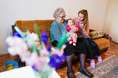 istock Grandmother, mother and baby at home 1144562741