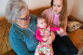 istock Grandmother, mother and baby at home 1144562760