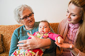 istock Grandmother, mother and baby at home 1144562768