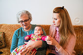 istock Grandmother, mother and baby at home 1144562784
