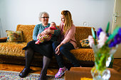 istock Grandmother, mother and baby at home 1144562800