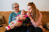 istock Grandmother, mother and baby at home 1144562802