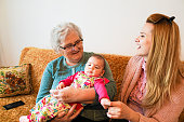 istock Grandmother, mother and baby at home 1144562836