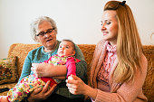 istock Grandmother, mother and baby at home 1144562837