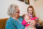 istock Grandmother, mother and baby at home 1144562852