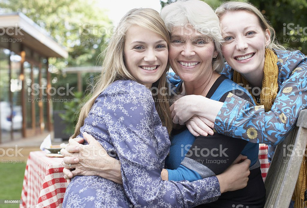 Grandmother, mother and daughter hugging royalty-free stock photo