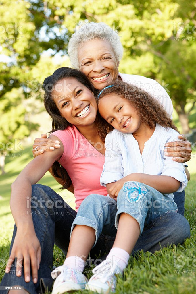 Grandmother, Mother And Daughter Relaxing In Park stock photo