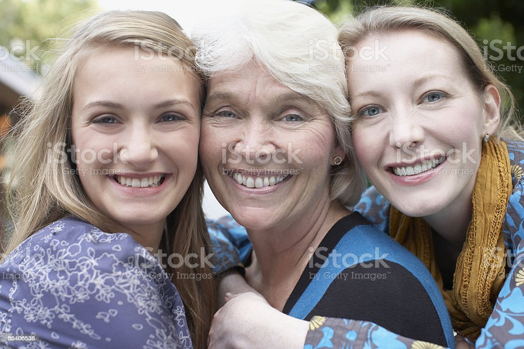 Grandmother, mother and daughter smiling royalty-free stock photo