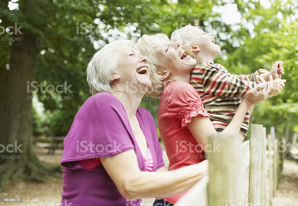 Grandmother, mother and son enjoying park royalty-free stock photo