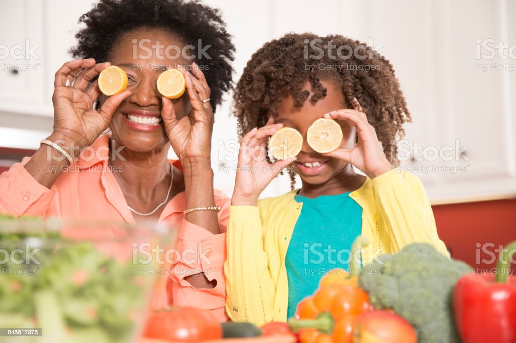 Grandmother or mother and daughter cooking together in home kitchen. stock photo