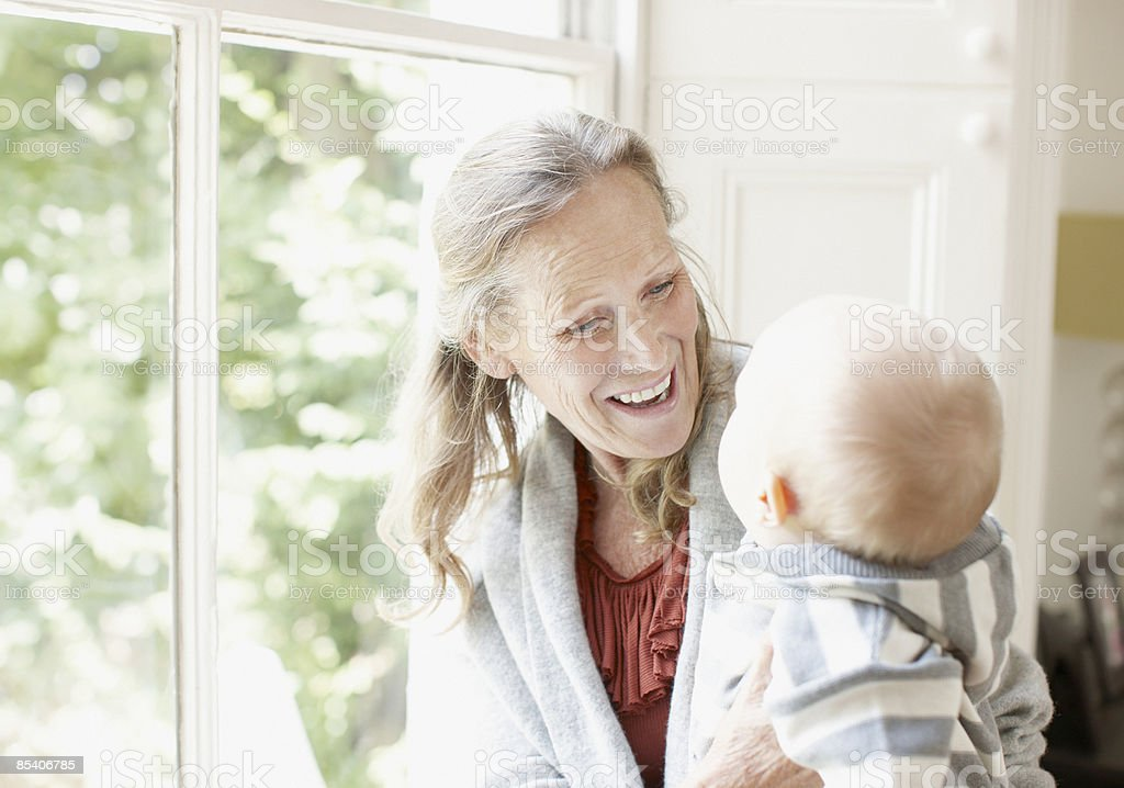 Grandmother playing with grandson royalty-free stock photo