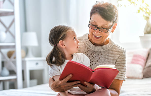 Grandmother reading a book stock photo