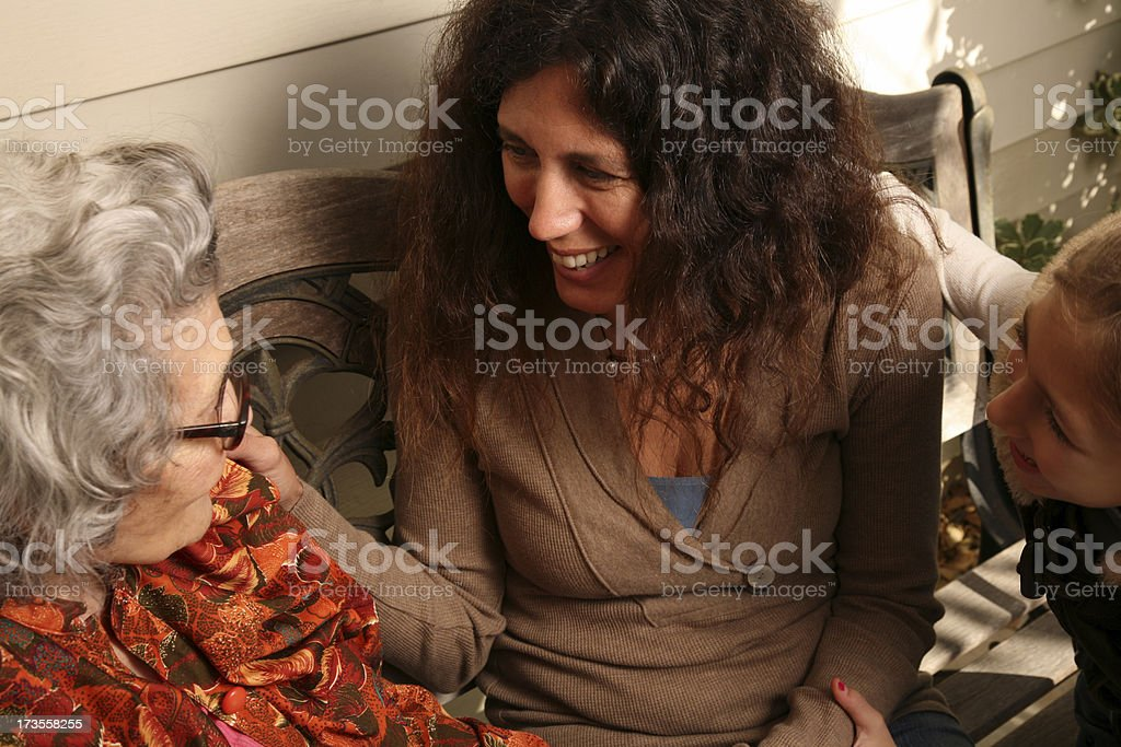 Grandmother sitting on Porch with Family royalty-free stock photo