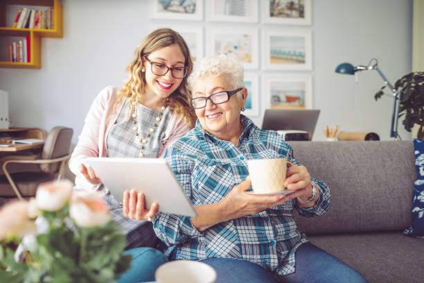 grandmother spending time with her granddaughter - mothers day stock pictures, royalty-free photos & images