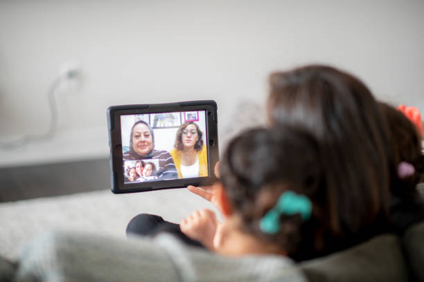 Grandmother video calls her family. stock photo