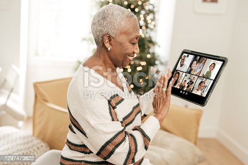 Grandmother waiving to her relatives during online call