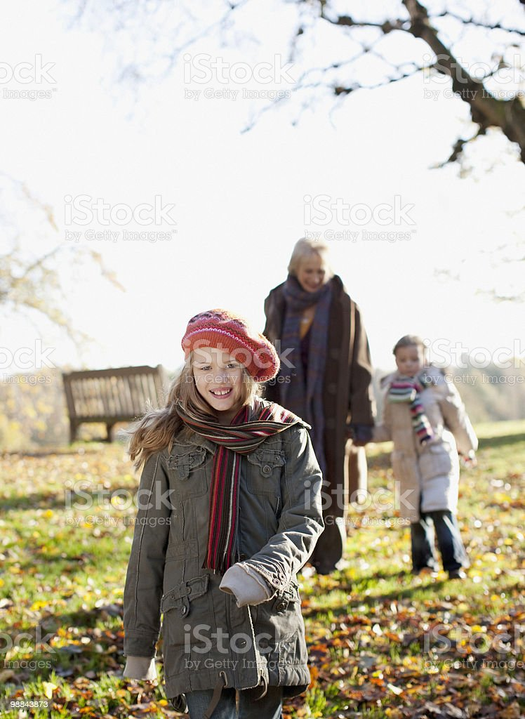 Grandmother walking in park with granddaughters royalty-free stock photo