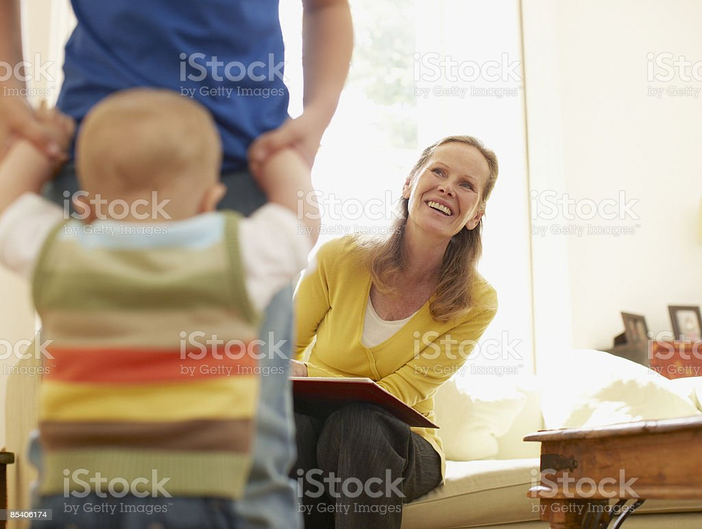 Grandmother watching grandchildren playing royalty-free stock photo