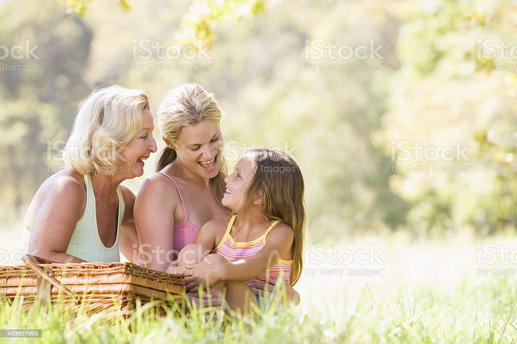 Grandmother with adult daughter and grandchild on picnic stock photo