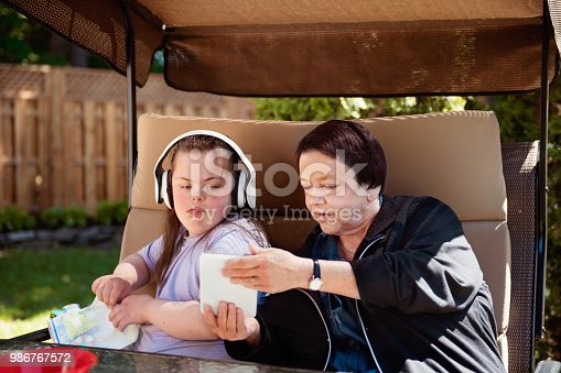 istock Grandmother with Autistic and Down Syndrome granddaughter Autism and Down Syndrome in daily lives 986767572