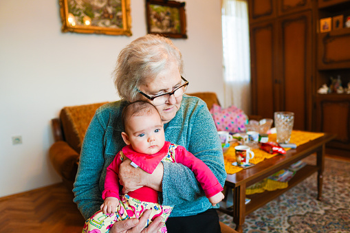 1088637186 istock photo Grandmother with baby girl 1144562880