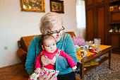 istock Grandmother with baby girl 1144562880