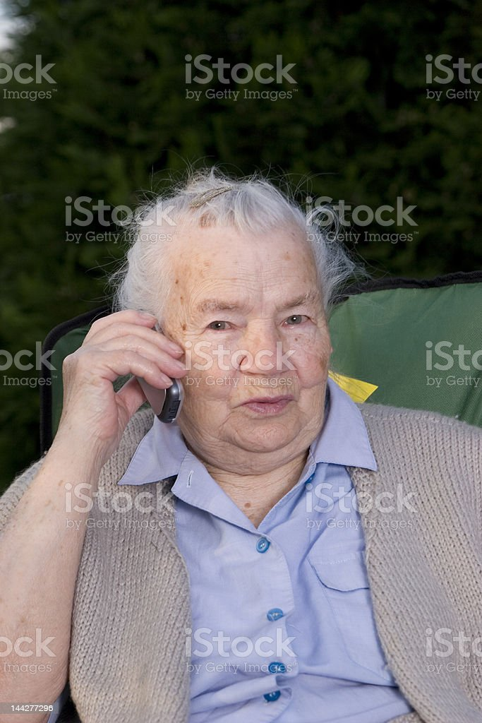 Grandmother with cell phone royalty-free stock photo