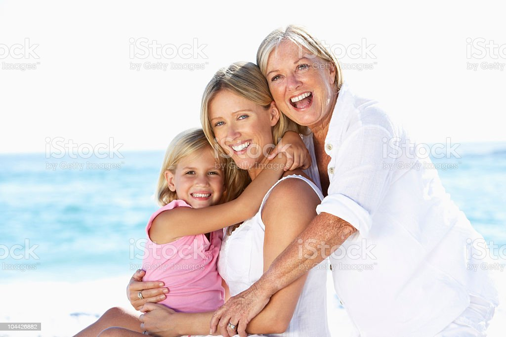 Grandmother With Daughter And Granddaughter On Holiday stock photo