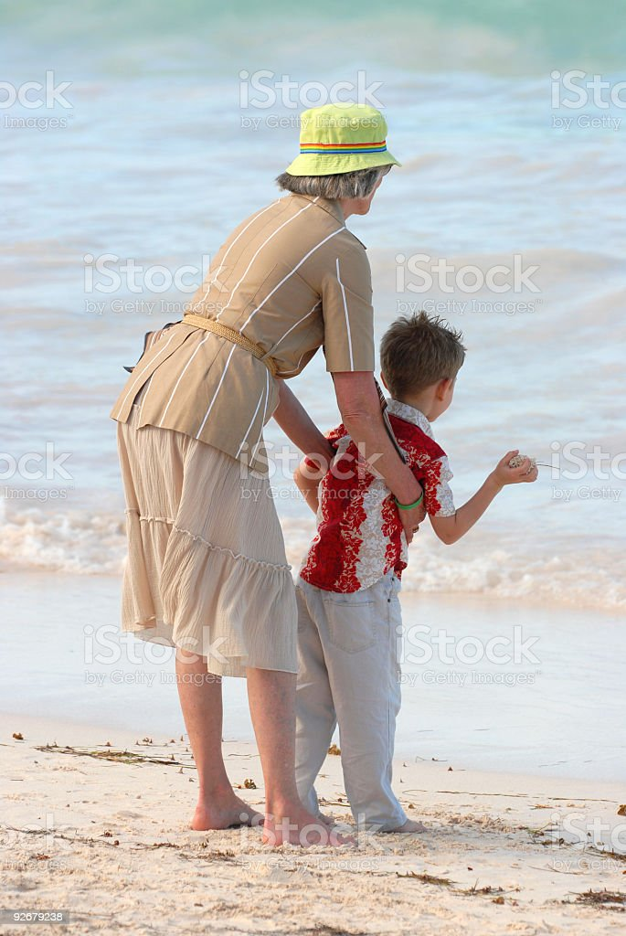 Grandmother with grandchild by the sea royalty-free stock photo