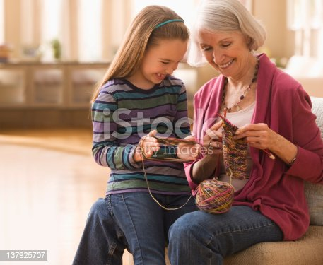 istock Grandmother with granddaughter getting ready to knit 137925707