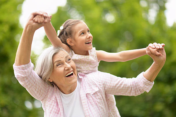 grandmother with granddaughter  in park - granddaughter and grandmother stock photos and pictures