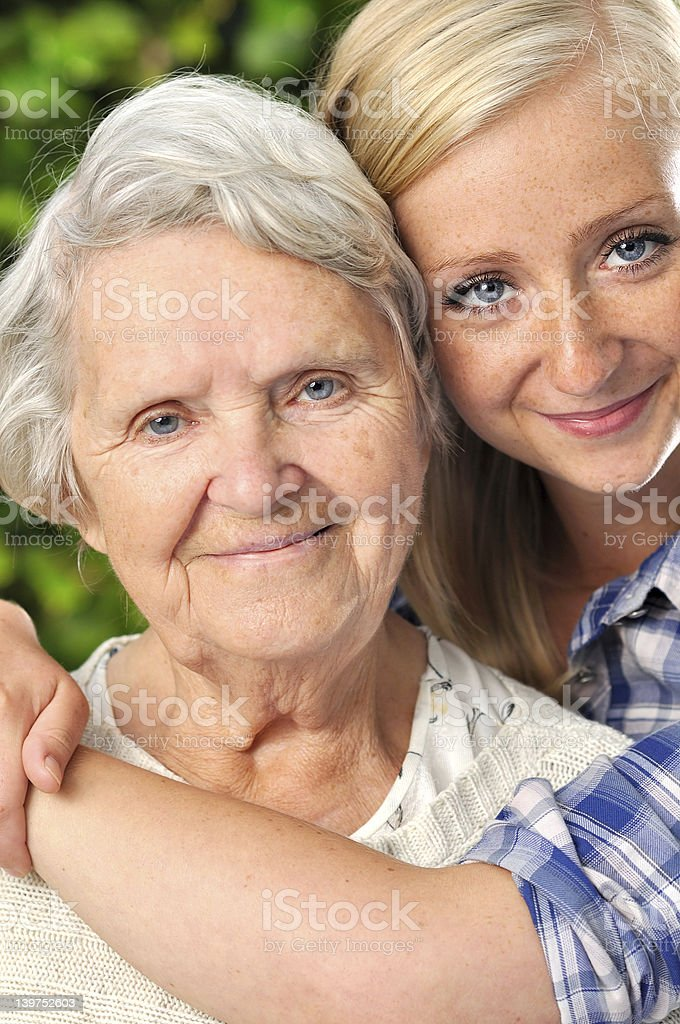 Grandmother with granddaughter. Smiling and happy. royalty-free stock photo