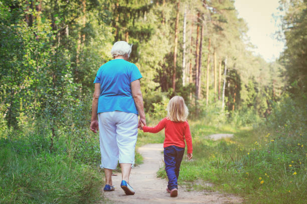 grandmother with granddaughter walk in nature - granddaughter and grandmother stock photos and pictures