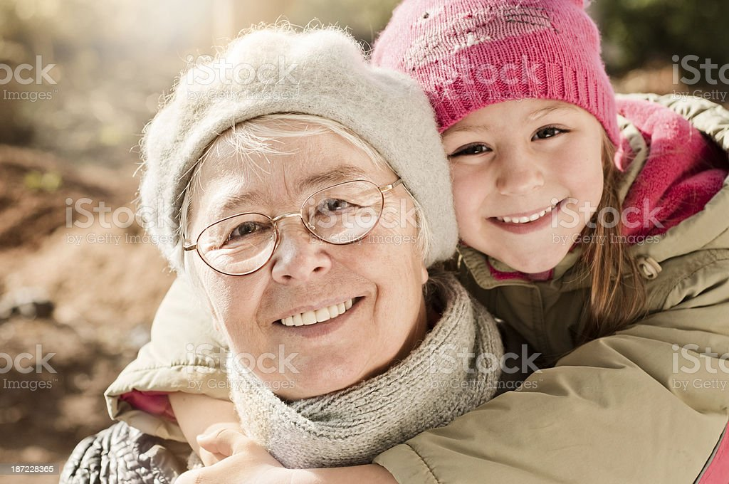 Grandmother with her grandaughter smiling. royalty-free stock photo