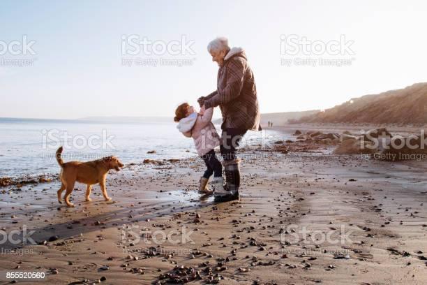 Grandmother with her granddaughter on the beach picture id855520560?b=1&k=6&m=855520560&s=612x612&h= 5gglrs nsf732nvkt7yddw46ttbi91kklhe22i1nbu=