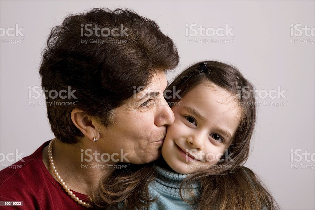 Grandmother's kiss royalty-free stock photo