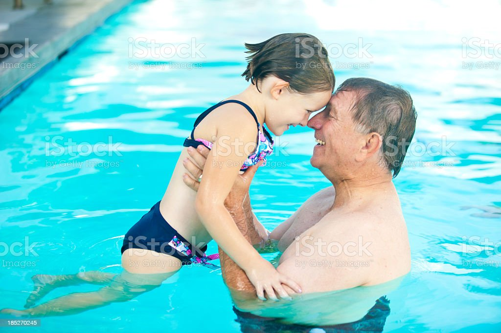 Grandpa and Granddaughter In Pool royalty-free stock photo