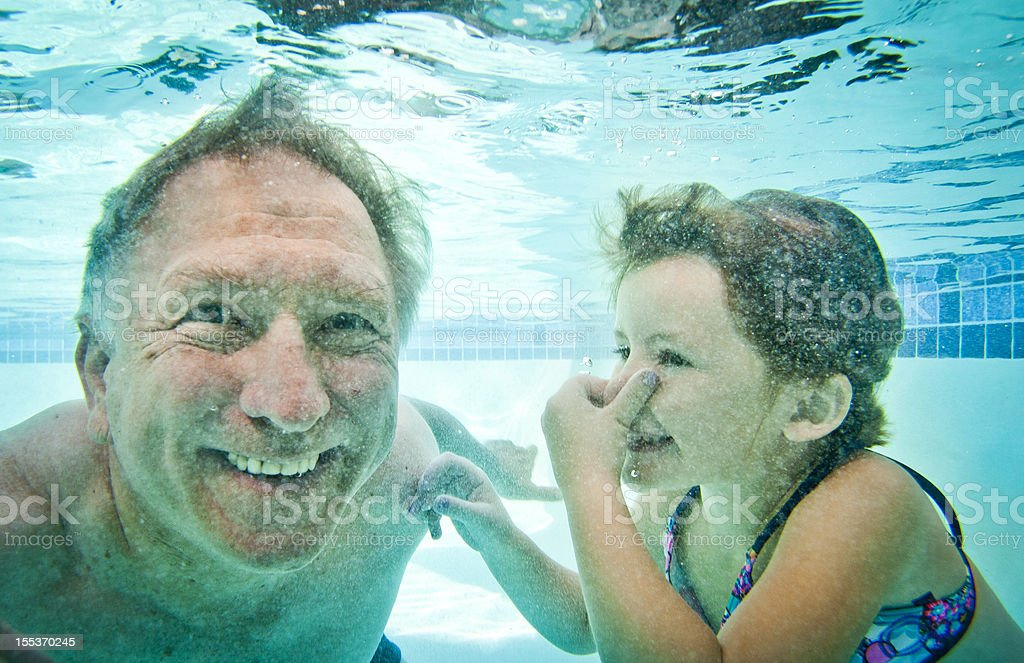 Grandpa and Granddaughter Underwater royalty-free stock photo