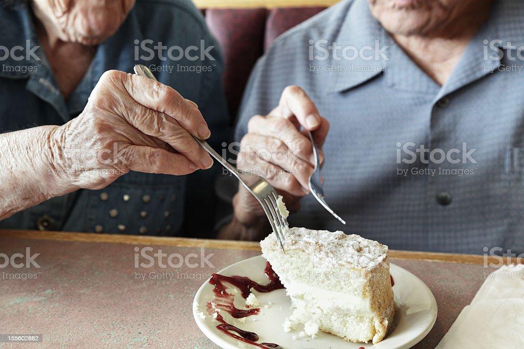 Grandpa and Grandma Sharing Cake stock photo