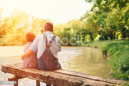 483319252istockphoto Grandpa and grandson fishing together. 473249028