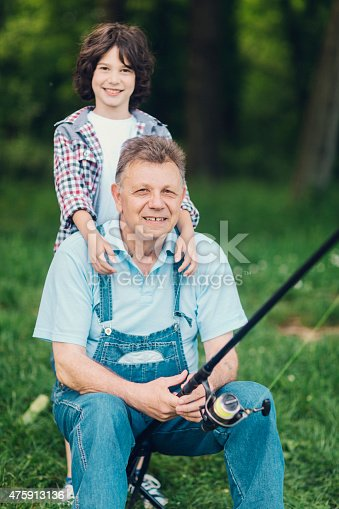 483319252 istock photo Grandpa and grandson fishing together. 475913136
