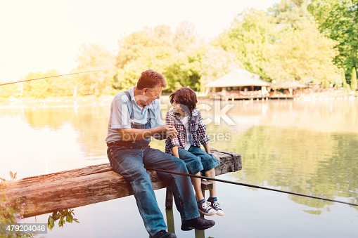 483319252 istock photo Grandpa and grandson fishing together 479204046
