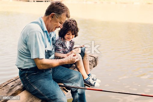 483319252 istock photo Grandpa and grandson fishing together 496923972