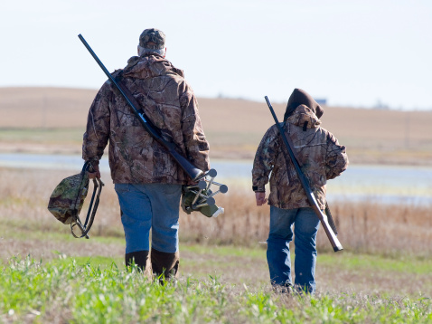 Grandpa and Grandson going Duck Hunting