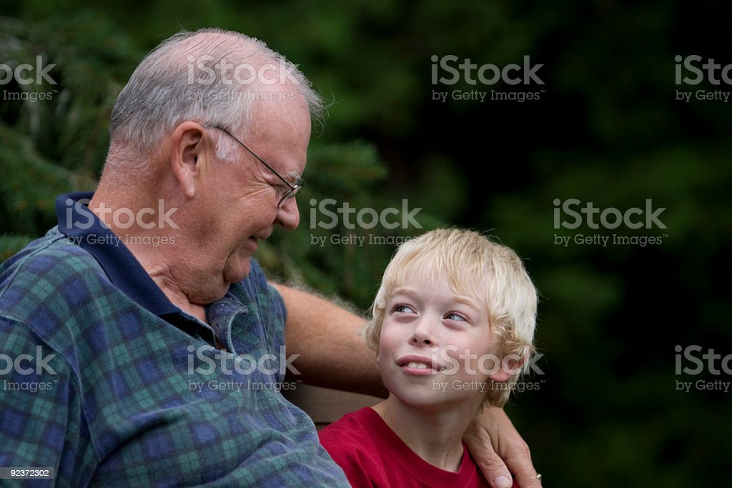 Grandpa and grandson in happy conversation royalty-free stock photo