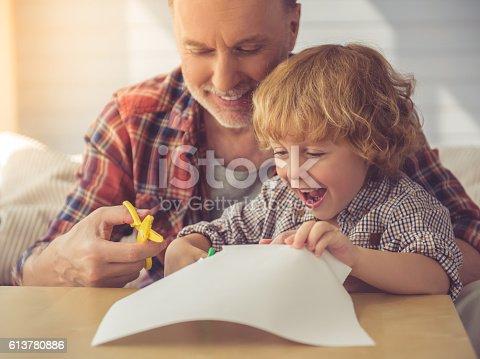 istock Grandpa and grandson 613780886