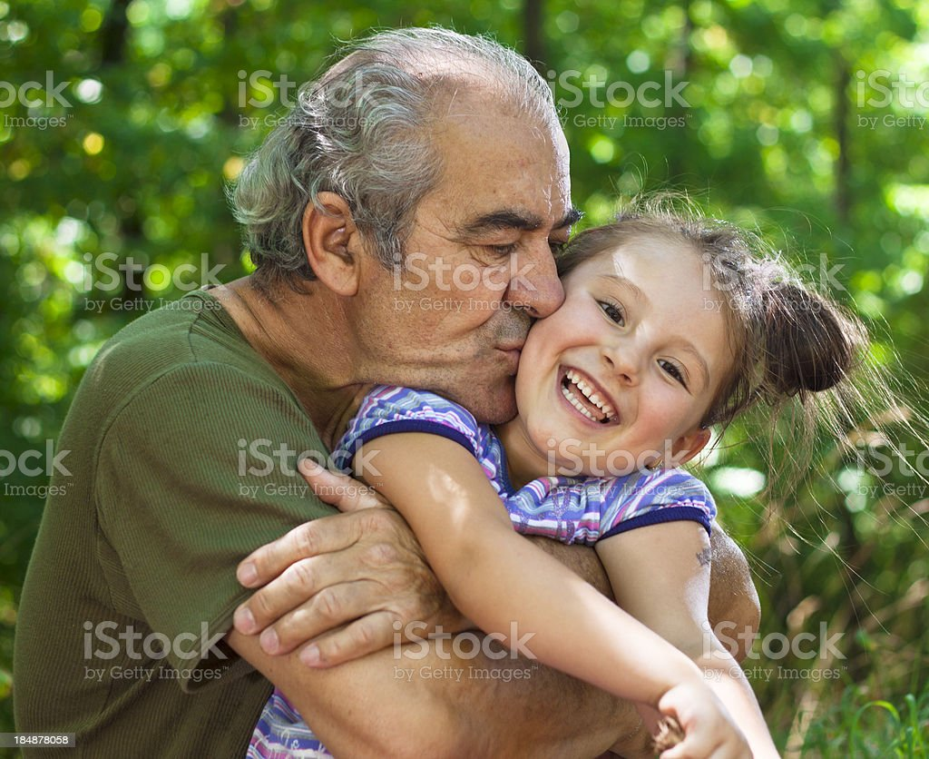 Grandpa and kid in nature royalty-free stock photo